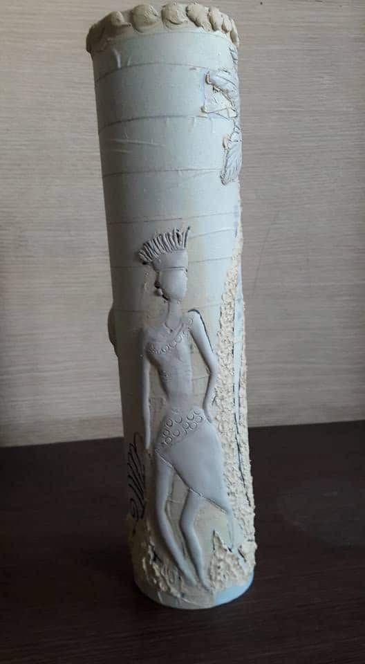 pot made with waste pipe and clay work.